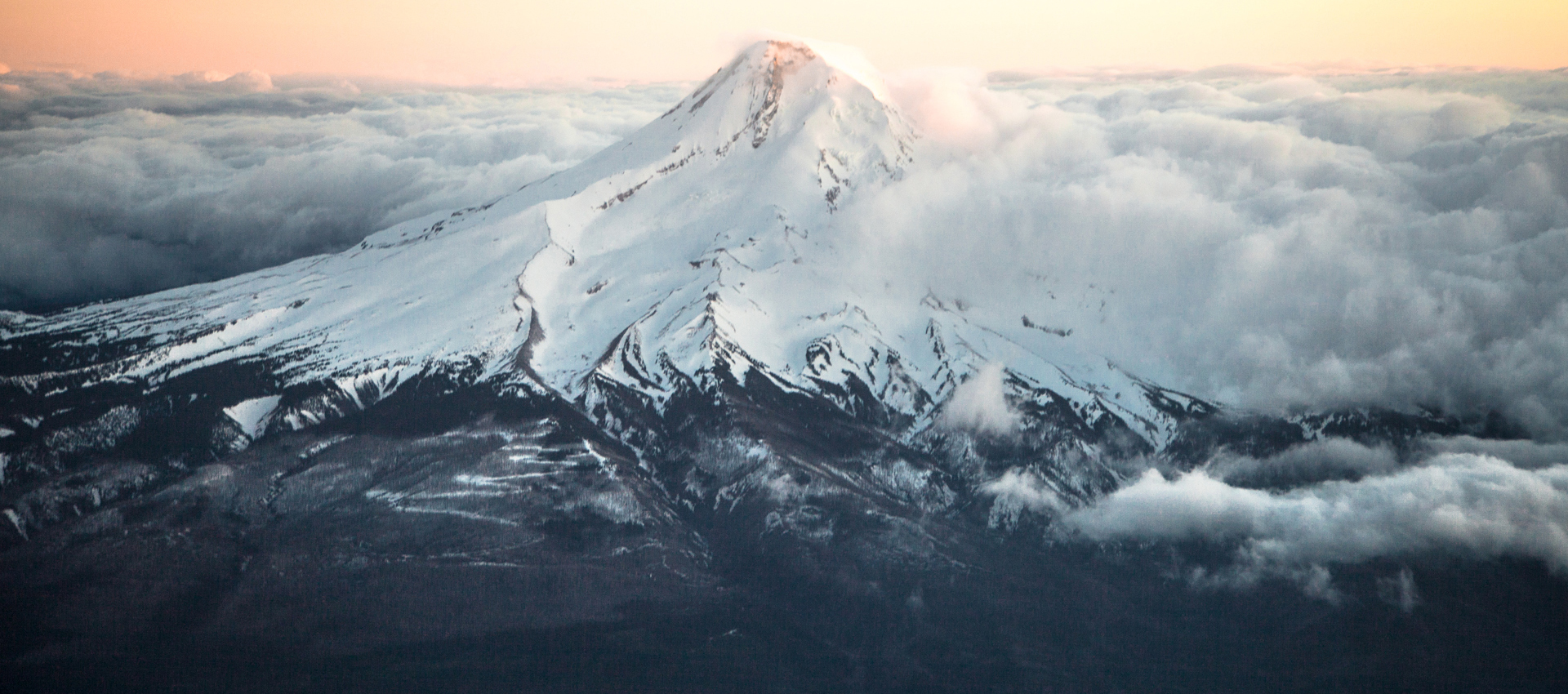 Mt. Hood with billowing clouds close to sunset